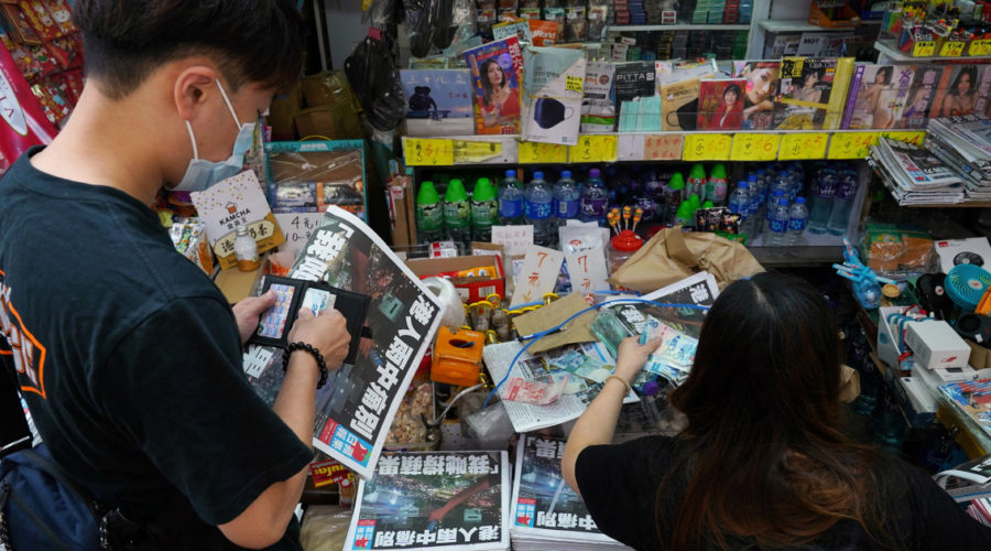 Hong Kong police arrest Apple Daily reporter at airport days after newspaper closes