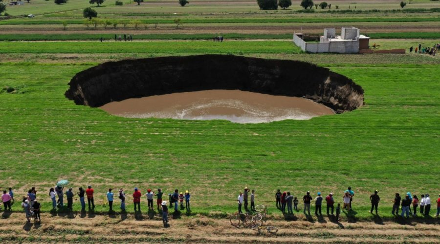 Massive sinkhole threatens home in Mexico's Puebla state