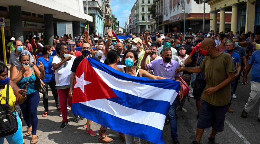 Thousands of Cubans protest against conditions on the island