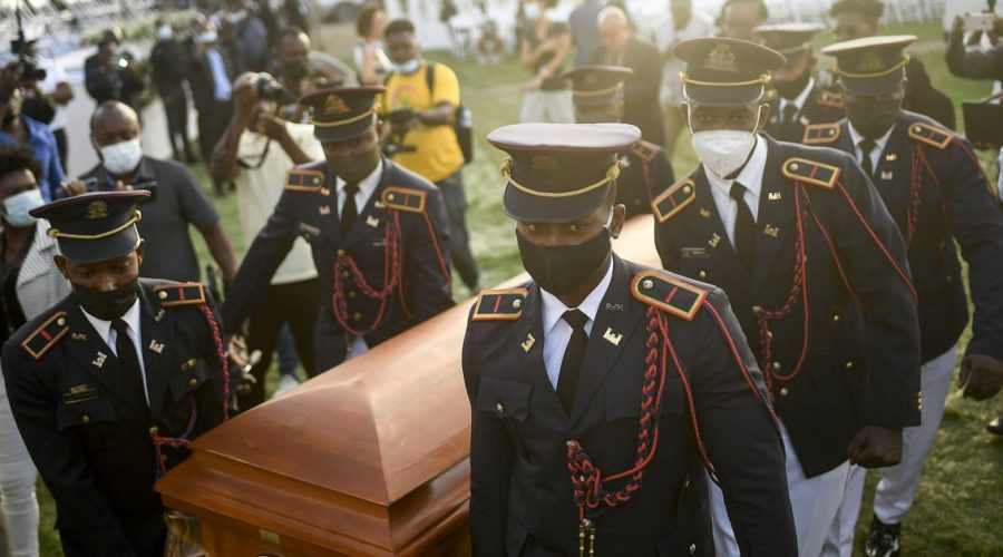 Dignitaries rush to cover themselves as protests erupt at Haitian president's funeral